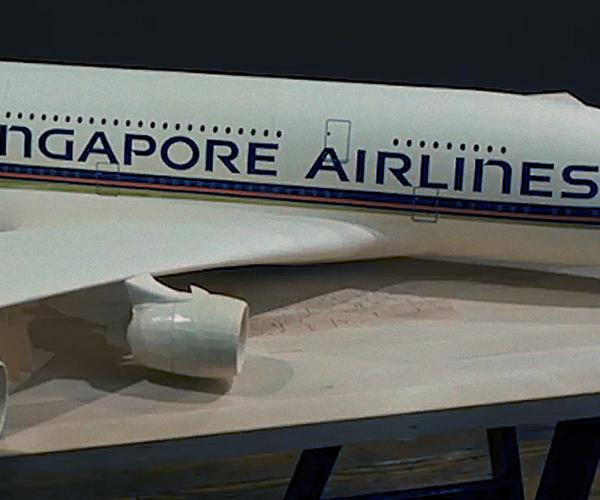 A DETAILED BOEING 777 MODEL JET FROM MANILA FILE FOLDERS