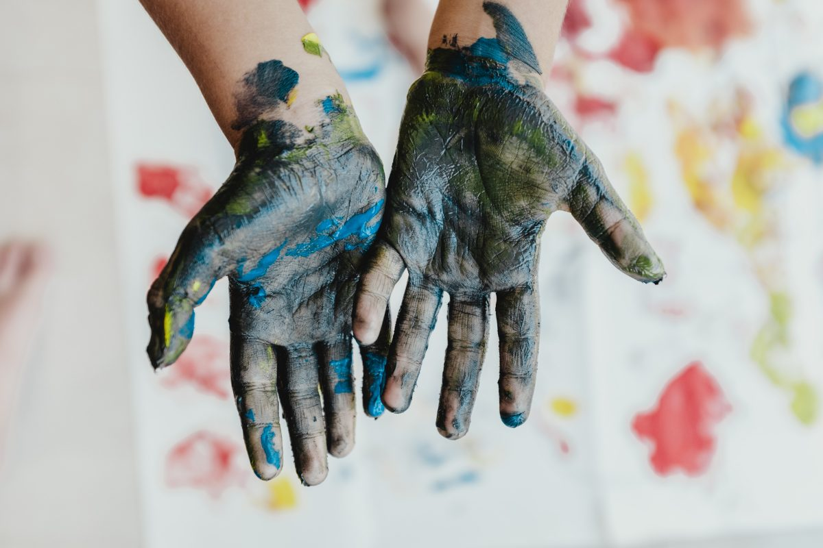 Hands covered with paint