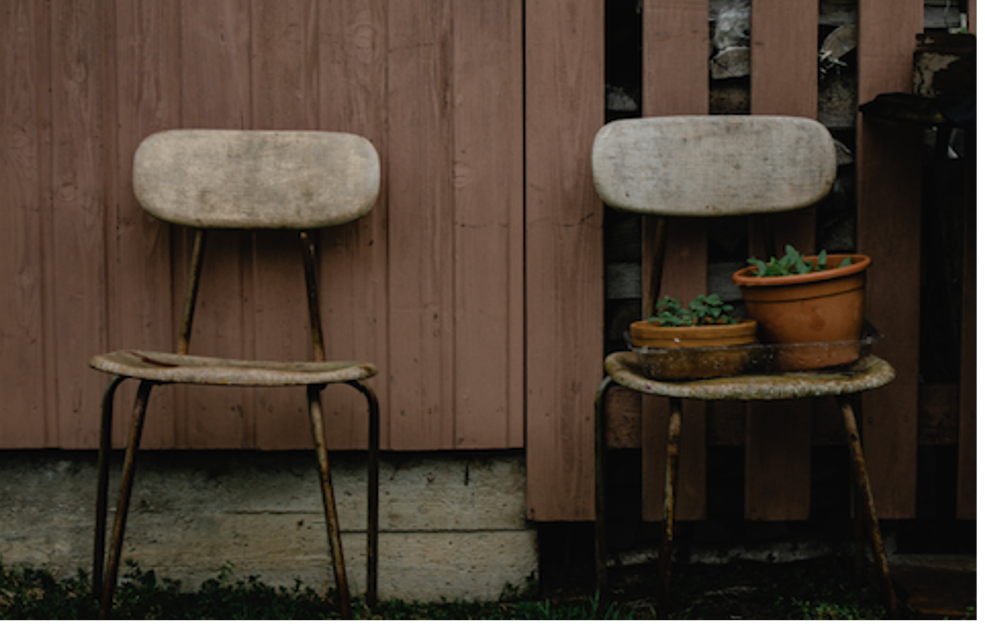 Two chairs with one carrying two pots